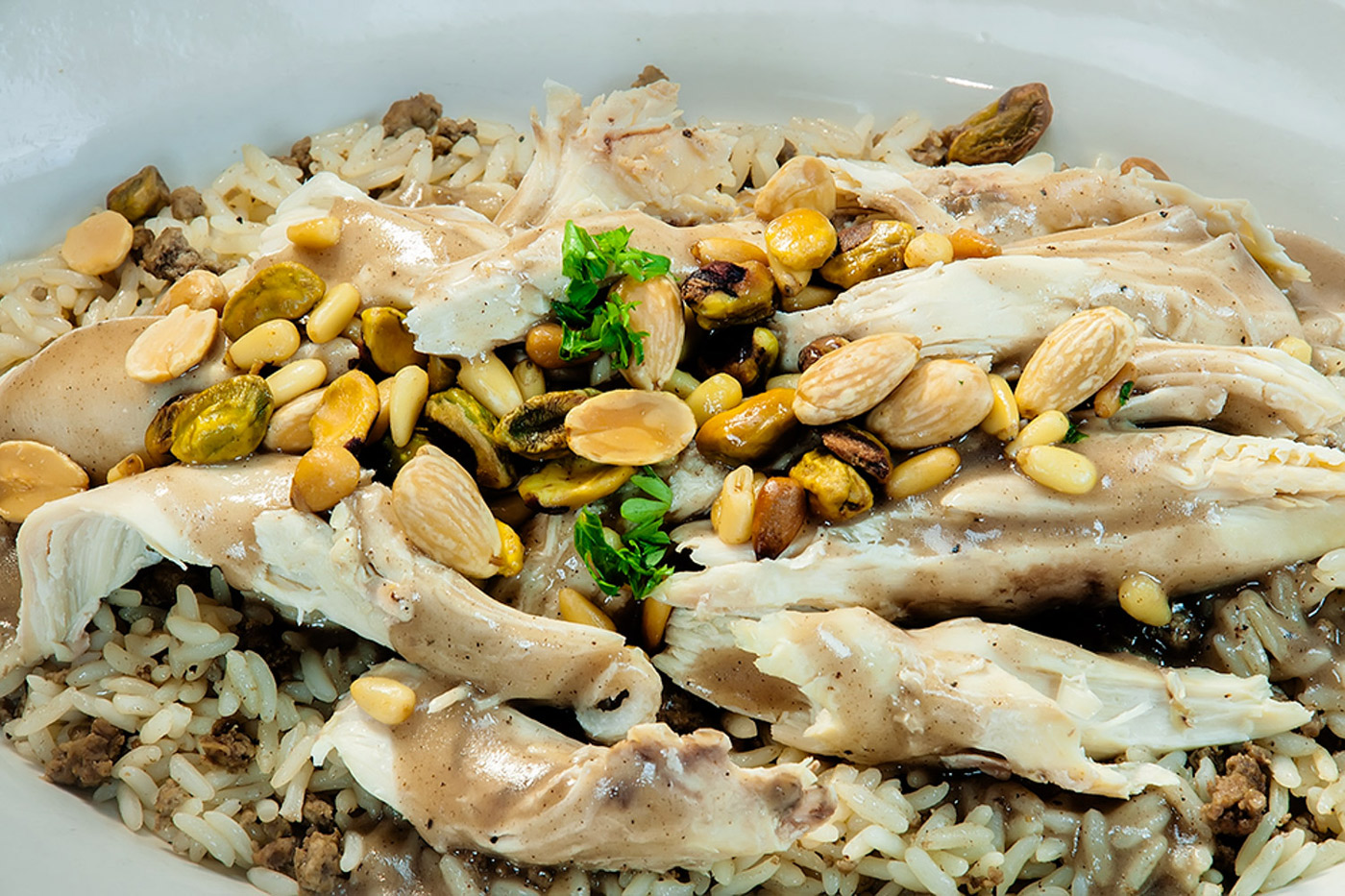 middle eastern dish with chicken, rice, and peanuts