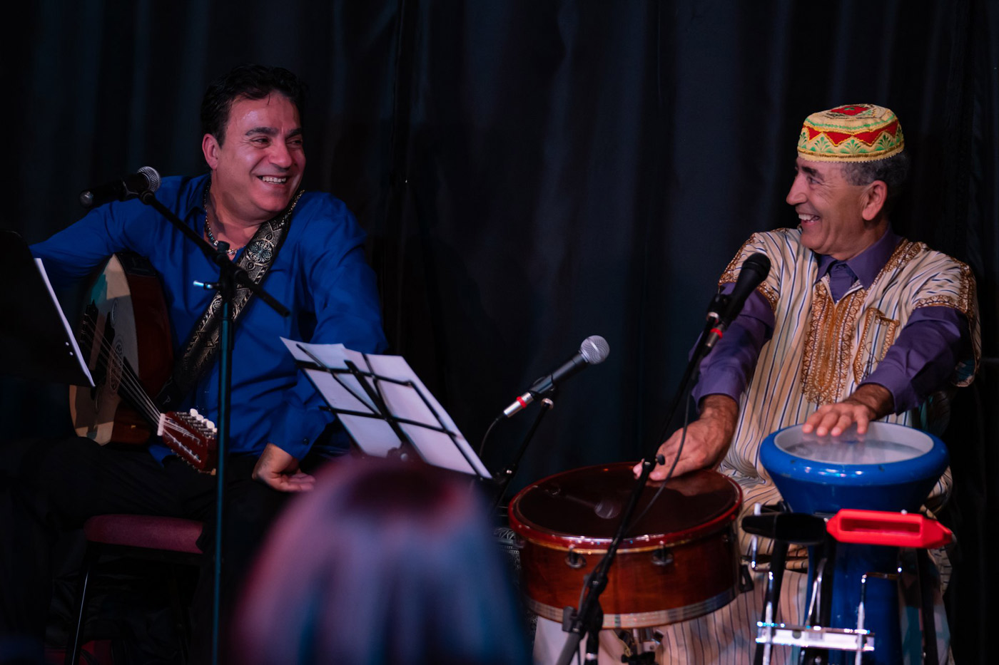george maalouf performing on stage with drummer