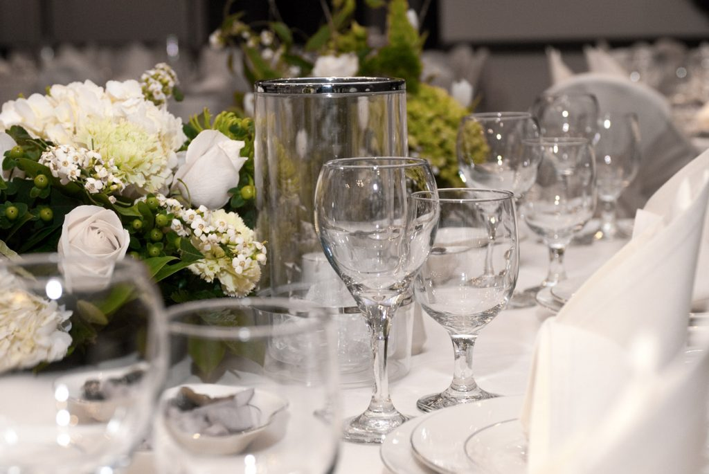 wedding table decorated with glasses and flowers